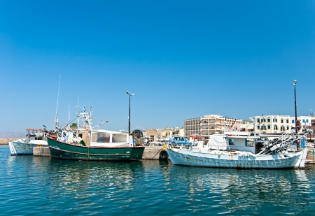 Greek fishing boat moored in the port city of Chania  Crete  photo
