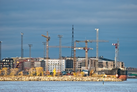 Construction of a new district on the Baltic Sea in Helsinki. Taken at sunset. photo
