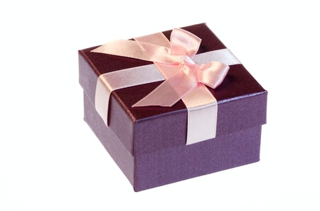 Gift box with a pink ribbon bow isolated on white background Stock Photo - 18464047