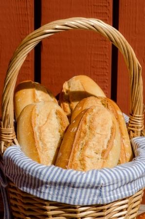 Crispy French baguettes in a basket. France.
