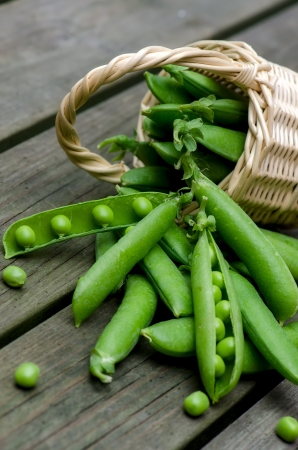 Fresh peas on a background of old boards