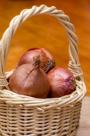 Basket of onions. Fresh vegetables photo