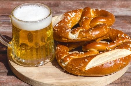 Oktoberfest Beer Mug and traditional German pretzels photo