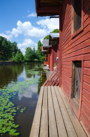 Porvoo, Finland. Old wooden red houses on the riverside photo