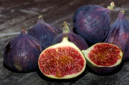 Figs on background of the old wooden table Stock Photo