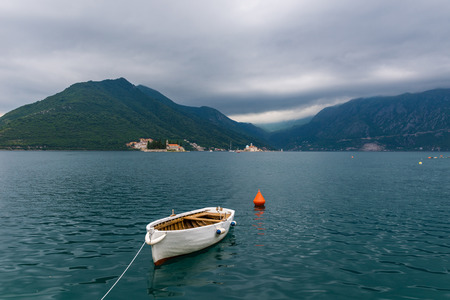 lonely boat in the bay. Perast, Montenegro.