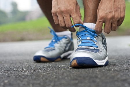 running shoes: Tying sports shoe