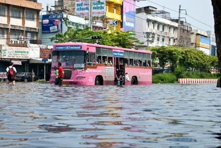 thailand flood: The bus on the flooding road ,Bangkok Flooding  Editorial