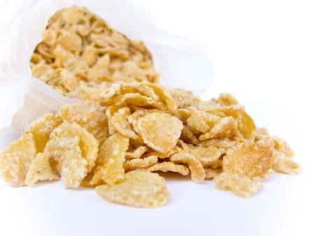 crunchy cornflakes on white background