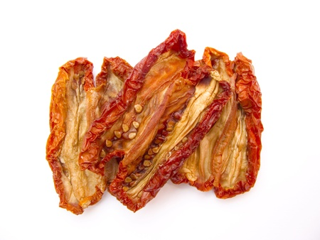 dried natural tomatoes isolated on white background