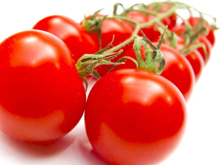 vegetable market: fresh red tomatoes isolated on white background