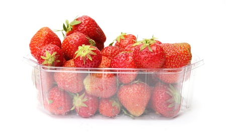 a punnet of strawberries isolated on white background photo
