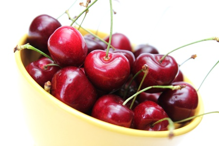 dish of cherries isolated on white background