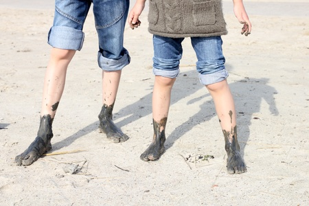 sandy feet: muddy feet in the tideland at the seashore