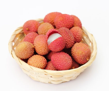 lichee: lychee in a little basket isolated on white background