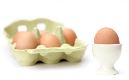 egg with egg cup and eggs in a package isoleted on white background Stock Photo