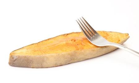single smoked halibut with fork isolated on white background Stock Photo