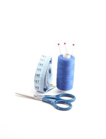 thimble: blue sewing kit isolated on white background