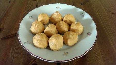 Sweet little cream puffs on plate