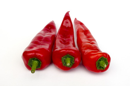 Three red peppers pointed Stock Photo