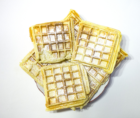 christmas baker's: delicious waffles with powdered sugar Stock Photo