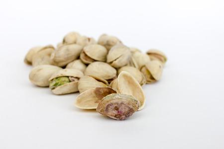 roasted pistachios isolated on white background Stock Photo