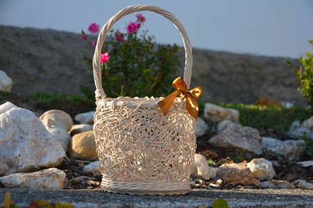 The wicker basket with brown ribbon
