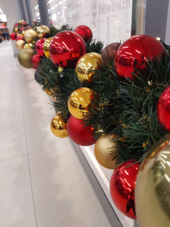 The Christmas chain with gold and red balls
