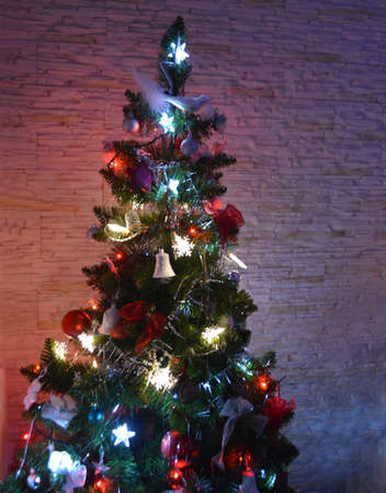 The Christmas tree with colored lights