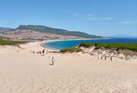 Landscape beachscape from dunes of playa de bolonia, august 2020. People enjoying summer, panoramic view