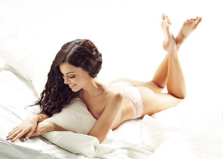 sexy feet: Dark-haired lady with fabulous body Stock Photo