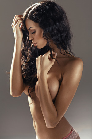 brunette naked: Tawny brunette woman with the perfect complexion Stock Photo