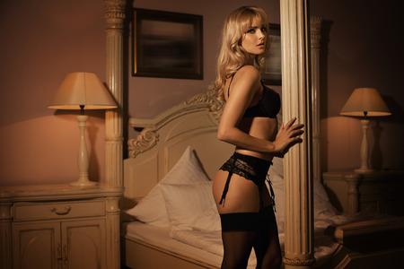 Sensual woman in the romantic bedroom