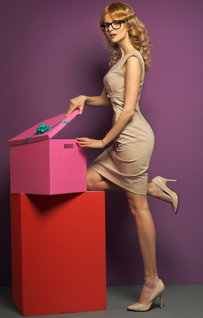 Attractive blond woman with the gift box photo