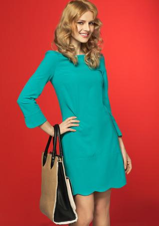 Smart woman holding the handbag