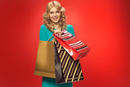 Alluring blonde with couple of shopping bags photo
