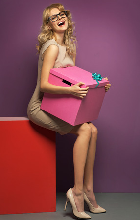 Laughing woman with the huge gift box photo