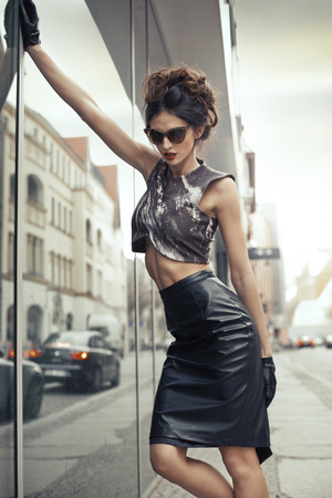 Elegant adult woman posing outdoor