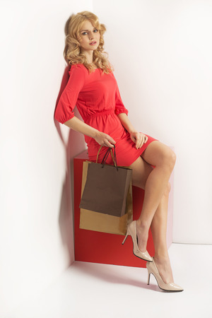 Tired blond woman with the shopping bags