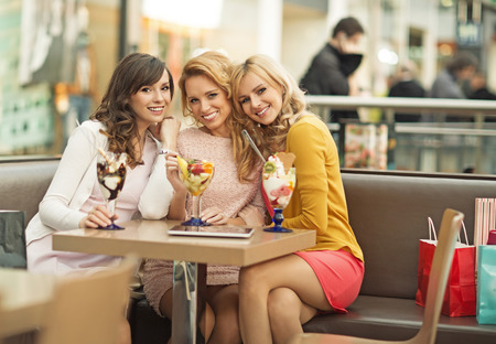 Portrait of the three young cheerful girlfriends photo