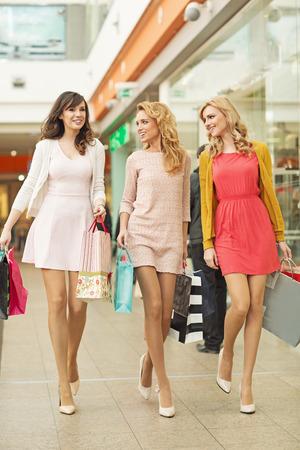 Three prettyl friends in the shopping mall photo
