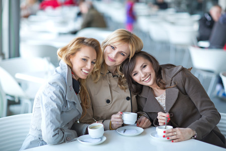Pleasant meeting in the small coffee shop photo