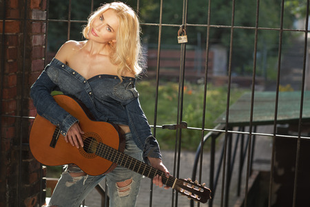 Sensual singer with the old guitar