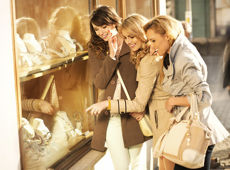 Young cheerful girlfriends looking at the jewellery photo