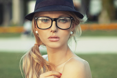 Portrait of the sensual blond woman with hat Imagens