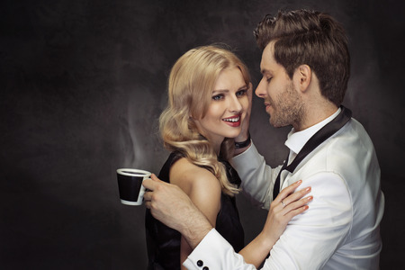 Young couple drinking coffee in the modern cafe photo