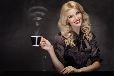Alluring blond lady drinking the coffee with the WiFi sign steam photo