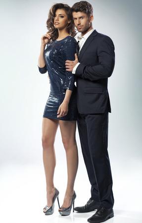 背の高いセクシーな妻を抱いてスマートな男 写真素材