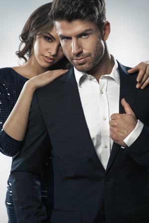 Alluring woman hugging her elegant boyfriend Stock Photo