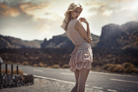 Portrait of the delicate blond woman in the exotic place 写真素材
